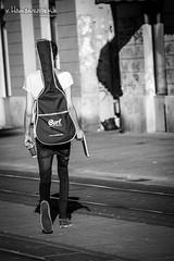 Street musician going home (v.Haramustek) Tags: street musician guitarplayer osijek slavonija croatia boy blackandwhite bw noir outdoor city art kreative monochrome going ngc