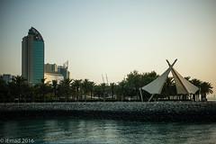 The walk and the city... (EHA73) Tags: summiluxm11450asph leica leicamp typ240 salmiya kuwait kuwaitscientificcenter city building towers trees sea seaside shoreline walk