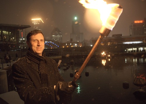 General Treasurer Seth Magaziner poses with a lighting torch during the WaterFire Lighting Ceremony. Photo by John Nickerson.