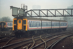 1307, Clapham Junction, February 13th 1993 (Southsea_Matt) Tags: greyhound cig route80 claphamjunction networksoutheast 1307 class421 class455 4cig 421307