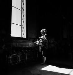 Girl at the window (Georgie Pauwels) Tags: street light shadow blackandwhite window public monochrome dark darkness candid olympus moment