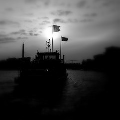 (blazedelacroix) Tags: shadow black ferry clouds stockholm flags hammarby sjstad