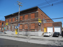 Red brick building - St-Remi (Vanishing Montral) Tags: history villedemontreal montreal histoire photography art architecture demolition disappearinghistory newconstruction