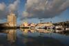 La Rochelle (at sunrise) (Michel Couprie) Tags: city sea mer france tower architecture port canon landscape eos harbor town towers larochelle michel tours charente couprie