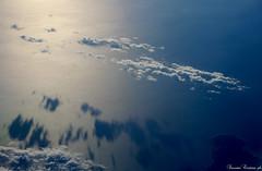 (LaKry*) Tags: sea sky reflection sunshine clouds plane fly meer nuvole mare himmel wolken cielo flugzeug aereo fliegen riflesso volare sonnenlicht wiederschein