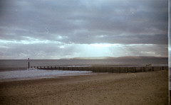 Silver Lining (Attila Pasek) Tags: bournemouth ilfordsportsman kodakgold200 beach camera film groyne lomo outofdate sand silverliningcloud sun