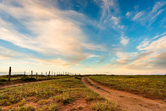 Southwest Dirt Road (James Duckworth) Tags: jamesduckworthphotography landscape southwest clouds dirtroad fence fenceline fineartphotography forever morning nobody nowhere outdoors outside road sky sunrise vanishingpoint wideopenplains wideopenspaces