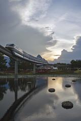 Epcot, Bay Lake, Florida (Atomic Eye) Tags: waltdisneyworld epcot orlando florida monorail reflection clouds sunset transportation themepark vacation experimentalprototypecommunityoftomorrow imagination pyramid future fountains