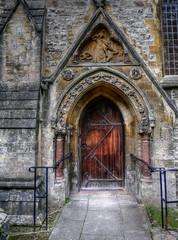 Llandaff Cathedral [Side Entrance] (All I want for Christmas is a Leica) Tags: panasoniclumixgf5 panasoniclumix14mm panasonic 14mm f25 panasoniclumix14mmf25 llandaff llandaffcathedral church churchesinwales churchdoor cardiff architecture doorway sideentrance tonemapped