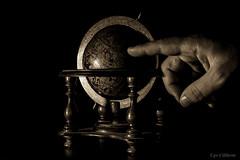 Identifichiamo il punto esatto ... (ugo.ciliberto) Tags: mondo mappamondo world globe worldmap mano hand seppia sepia vecchio old antico ancient