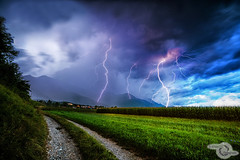 Lightning (Danijel Jovanovic Photography) Tags: lightning thunderstorm blitz gewitter weather wetter unwetter field feld path clouds sky sony alpha 7rii blue hour innsbruck tyrol tirol austria myinnsbruck