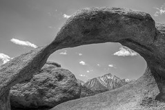 Mobius Arch and Lone Pine Peak - 6946_B&W (www.karltonhuberphotography.com) Tags: 2016 adventure alabamahills bw blackandwhite driftingclouds easternsierrafoothills exploring fairweatherclouds geologicformation geologichistory geologicwonder geology granite karltonhuber lonepinepeak mobiusarch mountainpeaks naturalarch naturalframe naturalworld nature outdoors rockformations rocks rugged wildplaces