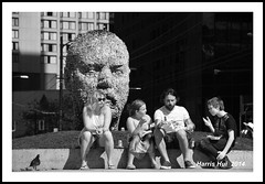 The Gum Head Family Lunch Gathering - Robson N15545e (Harris Hui (in search of light)) Tags: bw canada monochrome vancouver blackwhite nikon bc candid streetphotography richmond publicart digitalbw robsonstreet douglascoupland vancouverartgallery d300 candidportrait downtownvancouver streetcandid nikon18200mmvr nikonuser nikond300 harrishui vancouverdslrshooter gumhead