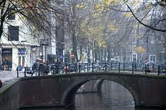 Misty Canal (padraicsmeehan) Tags: bridge winter light sculpture mist netherlands dutch amsterdam festival fog licht canal bikes overcast bicycles kanaal brug cycles 2014 sculpturen