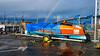 Ocean rowing boat (Martin Carey) Tags: uk greatbritain bridge orange wheel tarmac warning scotland rainbow unitedkingdom samsung gb rowing trailer 52 southqueensferry forthroadbridge gbr rowingboat oceanrowing samsungphotography samsunggt19505 february222015