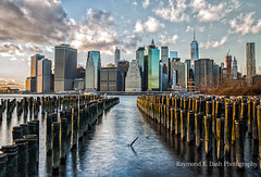 A Brooklyn View of Manhattan (ImagesByRayD) Tags: nyc winter sunset sky cold color water skyline clouds landscape downtown cityscape waterfront skyscrapers jan manhattan eastriver waterway nycskyline 2470mm 2015 freedomtower dumbobrooklyn canon5dmarkiii