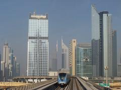 A metr a Sheikh Zayed Road mentn, httrben az Emirates Towers (355 m, 56 emelet) (sandorson) Tags: travel dubai uae unitedarabemirates  duba   dubaj    sandorson dubi egyesltarabemrsgek