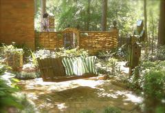 Soakin' Up Some Sunshine (MaryLou1298) Tags: sunshine garden swing springtime birdhouses gardengate gardentour