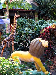 Not Your Everyday Temple Guardians (John 3000) Tags: travel art animals gardens thailand temple asia buddhist wildlife lion statues chiangmai animales giraffe wat statuary whimsical guardians menagerie 2015 buppharam thailand2015