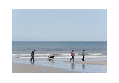 Three people walking with two dogs on the beach (Pictures from the Ghost Garden) Tags: nikon d7100 dslr 18105mm unitedkingdom uk wales pembrokeshire amroth coast coastal seaside sky blue people reflections dogs beach landscape seascape