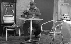 Enjoying a CISK in It Tokk (AnnieW69) Tags: rabat kinnie peoplewatching nikon ittokk wwwanniewilcoxcouk cisk victoriarabat mediterranean 2015 pjazzaindipendenza urbanphotography september blackwhite beer photographytechnique animotogozo bw monochrome cafe building photography commercialbuilding gozo bar d7000 europe malta anniewilcox mt malita blackandwhite cityphotography coffeehouse edifice edifices pub