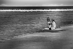 Sisters looking into the distance. (Dain Schlegel) Tags: sisters distance sitting overlooking lake michigan kenosha wisconsin summer 2016 blackwhite pier