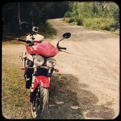 Riding on dirt road (aixcracker) Tags: triumph speed triple 955i lappträsk lapinjärvi suomi finland dirtroad sandväg hiekkatie july juli heinäkuu summer sommar kesä bike motorcykel motorcycle moottoripyörä iphone