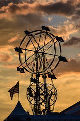 Skywheel Sunset (tim.perdue) Tags: skywheel double ferris wheel ride sky clouds sunset evening tent american flag silhouette ohio state fair 2016 summer exposition center columbus street candid colorful multicolored midway carnival