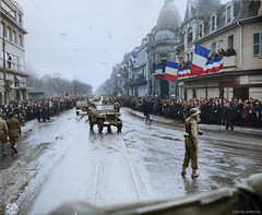 With great joy, newly liberated Frenchmen and Frenchwoman of Colmar, France, welcome convoys of the 28th Infantry Division, February 3rd, 1945. (Jared Enos) Tags: france colmar wwii world war ii liberated liberation infantry usa us army flags flag crowd happy joy celebration history colorized colorization