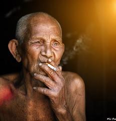 The elderly was smoking (truonghaison81) Tags: vietnam vietnamese people portrait portraits person viet mood male asia asian elderly emotion countryside smoke smoking life