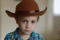 The pensive cowboy. (macmirabile) Tags: portrait cowboy child f18 18 nikon85mm d600 nikond600