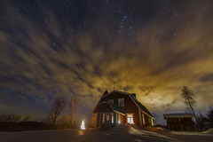 Warming up the Stars (MilaMai) Tags: stars starsky night nightview redhouse hill nightsky cloudformation clouds longexposure lights illuminate door window moonlit moody atmospheric mysterious dramatic beautiful milamai trees barn cabin redcabin easternfinland astro winter winterscene snow north joensuu outdoors horizontal landscape snowscape magical lightpollution motion constellations dramaticsky bigcloud original spruce shine cabininthewoods finnish countryside finland suomi europe home building red cottage enlighted illuminated winterwoods timelapse
