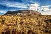 Knocknarea (dubdream) Tags: ireland sky cloud house mountain landscape village olympus gras agriculture cloudysky sligo knocknarea countysligo strandhill colorimage dubdream
