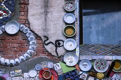 1407 (cristianachivarria) Tags: streetart detail window streetphotography slovenia tiles ljubljana metelkova
