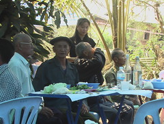 Relatives Drink and Eat at Death Anniversary