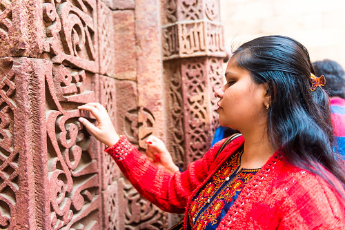 Accessible Tour of Qutub Minar: A traveller who is blind can be seen touching the carvings on the walls.