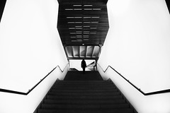 (cherco) Tags: light shadow blackandwhite woman blancoynegro geometric girl up lines silhouette stairs composition canon vanishingpoint alone geometry sombra 5d lonely silueta solitary solitario escaleras subir composicion