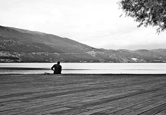 () Tags: tree sky lake mountains water city man sitting figure clouds view wood bw blackandwhite monochrome ioannina greece out outdoor