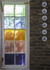 The window and the plates (Imthearsonist) Tags: window wall decoration colors simmetry objects things design plates souvenirs recuerdos diseo ventana muro decoracion