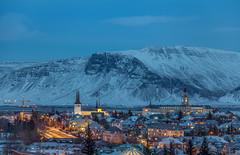 Downtown Reykjavik - Blue Hour (Jerry Fryer) Tags: reykjavik iceland bluehour cityscape snow mountains sea coast clouds blue landscape 5dmk2 water sky night city lights house church