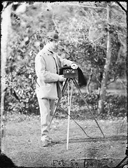 Lord Dunlo in garden with stereo camera (National Library of Ireland on The Commons) Tags: theclonbrockphotographiccollection lukegeralddillon baronclonbrock augustacarolinedillon baronessclonbrock dillonfamily nationallibraryofireland lorddunlo stereocamera lanternslide deerstalkerhat tripod lord clancarty crofton richardsomersetlepoertrench richardtrench earlofclancarty viscountdunlo locationidentified