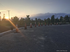 Plastic Sentries (scottnj) Tags: 365project cy365 227366 scottnj scottodonnellphotography godrays trafficcones curb cement sunset clouds sky outdoor blacktop asphalt construction redditphotoproject reddit365
