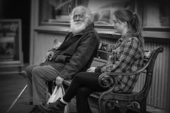 generaciones (Mauro Esains) Tags: abuelo seor mayor charla conversacin generaciones paseo arrugas paciencia sabiduria barba canas bastn retrato aire libre calle mujer joven bn