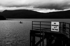 Now swinning at the pier (Full Frame Visuals) Tags: scotland roadtrip vacation highlands loch lomond landscape luss village blackandwhite schwarzweis fishing boat