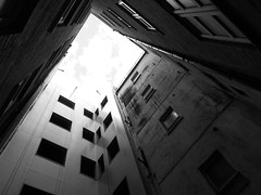 unbounded dreams (vfrgk) Tags: skylight architecture urban buildingdetail buildingcomplex windows lightandshadows light sky urbanphotography urbanlife urbanfragment urbanbeauty depressing moody lines geometric monochrome blackandwhite bw loneliness emptiness clouds lookingup lowpov perspective abstractarchitecture abstract nightmare