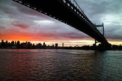 Astoria (MackaColorinche) Tags: nyc bridge astoria newyork water sunset cluds skyline sky