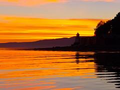 The lighthouse at sunset (estenvik) Tags: autumn beitstadfjorden erikstenvik estenvik evening fall fjord hst kveld nordtrndelag norge norway october oktober solnedgang steinkjer sundown sunset fyr fyrlykt lighthouse beacon