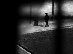 Pisa, 2016 (A-cat-and-a-half) Tags: shadow light harsh contrast pisa italy hat dark blackandwhite voyeur urban distance battistero pov street candid streetphotography pavement grass frame framed