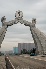 Reunification Arch in Pyongyang, North Korea, DPRK (tommcshanephotography) Tags: adventure asia communism dprk democraticpeoplesrepublicofkorea expedition exploring kimilsung kimjungil kimjungun northkorea pyongyang revolution secretcompass travel trekking