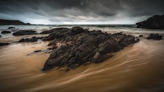 Heart of Darkness (Augmented Reality Images (Getty Contributor)) Tags: beach canon clouds coastline landscape leefilters longexposure morayshire rocks sand scotland seascape sunnysidebeach water waves